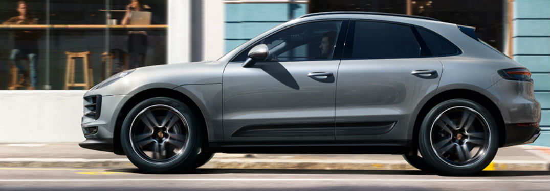 2019 Porsche Macan exterior drivers side going fast on town road