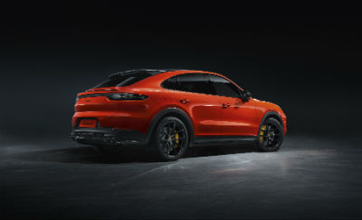 2020 Porsche Cayenne Coupe exterior back fascia passenger side with dramatic lighting