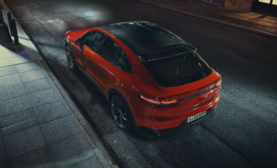 2020 Porsche Cayenne exterior top view back fascia and drivers side on dark street