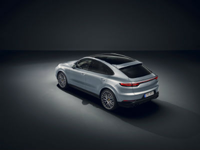 2020 Porsche Cayenne Coupe exterior back fascia and-driver side with dramatic gray lighting