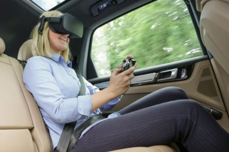 Woman using VR headset in the car