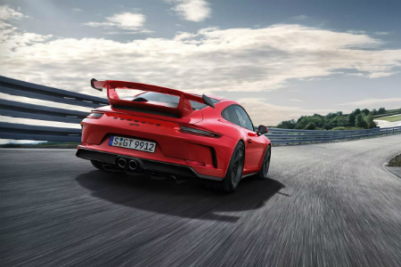 Rear view of a red 2019 Porsche 911 GT3 on track