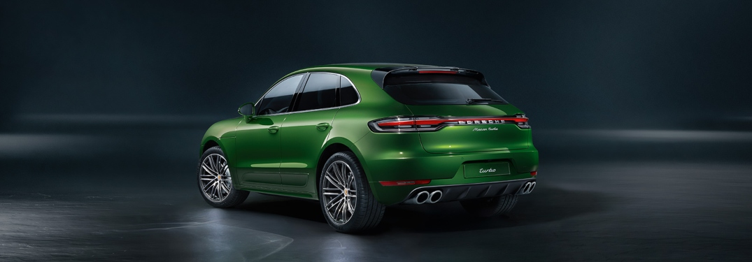 Rear side view of a green 2020 Porsche Macan Turbo
