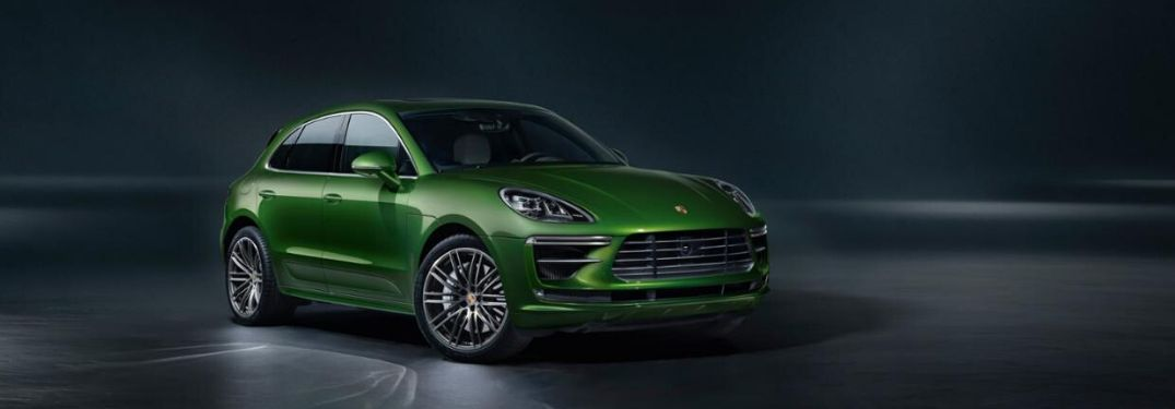 Green 2019 Prosche Macan Turbo in black room_o