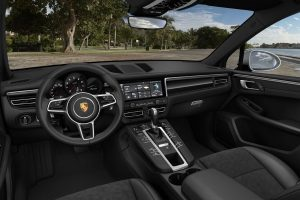 Interior of 2020 Porsche Macan showing front seat and dash and wheel