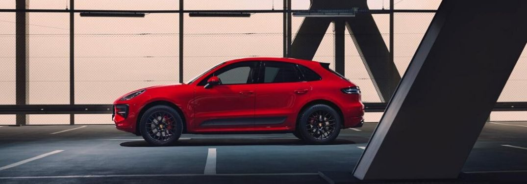 Red Porsche Macan GTS from exterior driver side