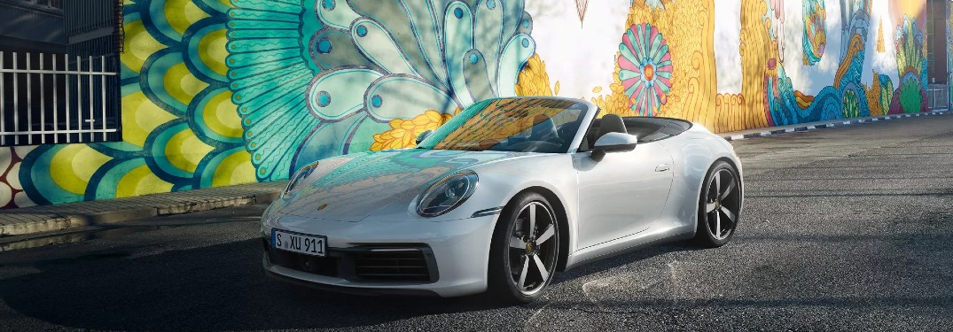 2020 Porsche 911 Carrera in front of painted wall