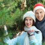 Young Couple Choosing a Christmas Tree