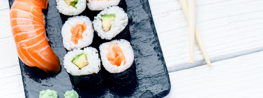 Sushi Served on a Plate with Wasabi and Chopsticks