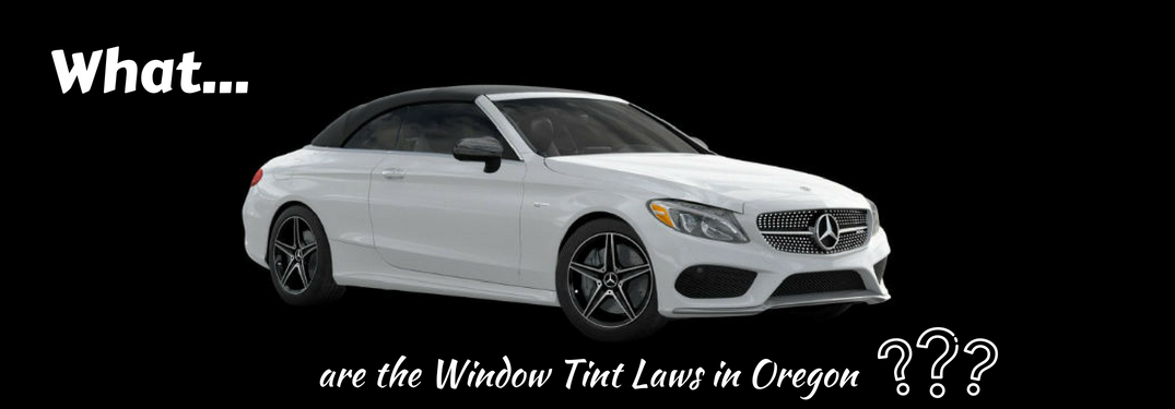 What...are the window tint laws in Oregon, text on a passenger side exterior view of a white 2018 Mercedes-Benz AMG C 43