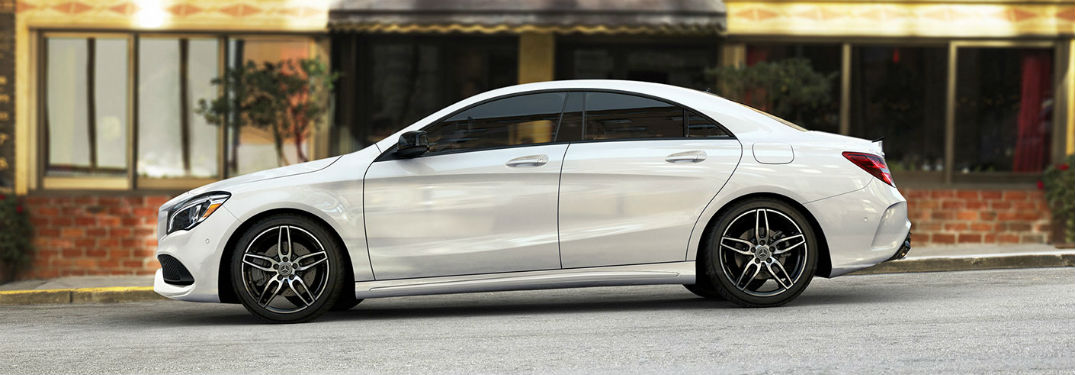 Driver side exterior view of a white 2019 Mercedes-Benz CLA
