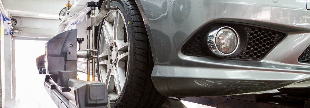closeup view of car tire being serviced in auto shop
