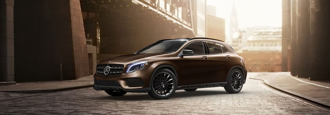 Front driver angle of a brown 2019 Mercedes-Benz GLA 250 parked in a street
