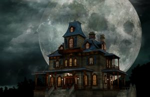 large scary looking house, moon in background