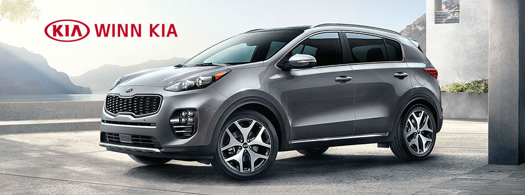 Gray 2017 Kia Sportage with Winn Kia logo