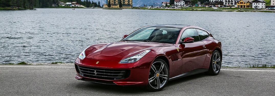 Ferrari GTC4lusso parked by the edge of a lake
