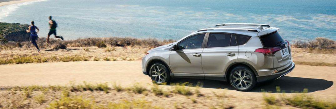 2018 Toyota RAV4 driving on a road in plans.