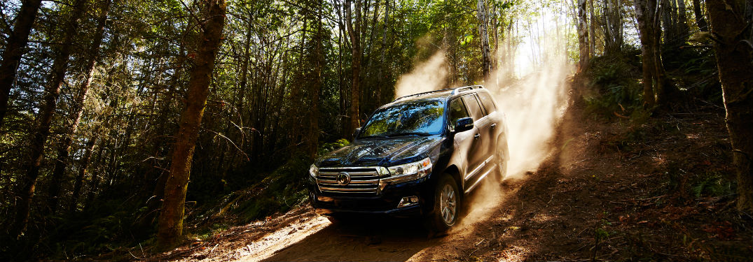 2018 Toyota Land Cruiser cresting a hill in a forest near Lexington Mass