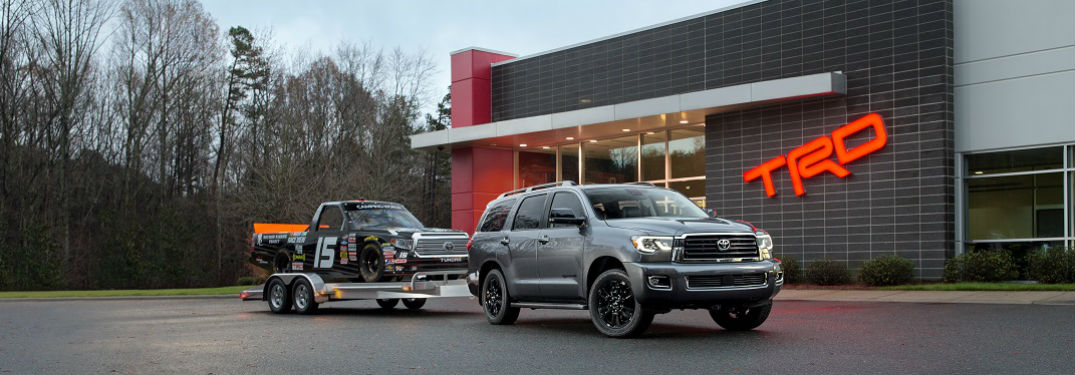 2018 toyota sequoia in silver color shown towing a truck in front of trd sport complex