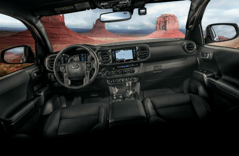 2018 Toyota Tacoma interior dash and wheel.