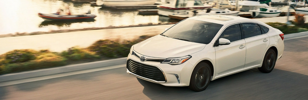 2018 Toyota Avalon driving down a road.