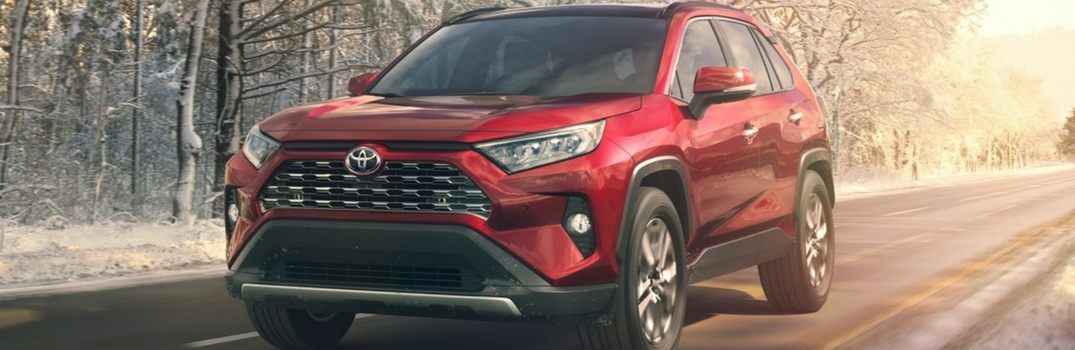 2019 Toyota RAV4 driving down road.