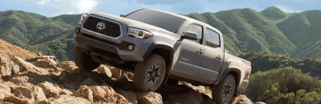 2019 Toyota Tacoma parked on the rocks