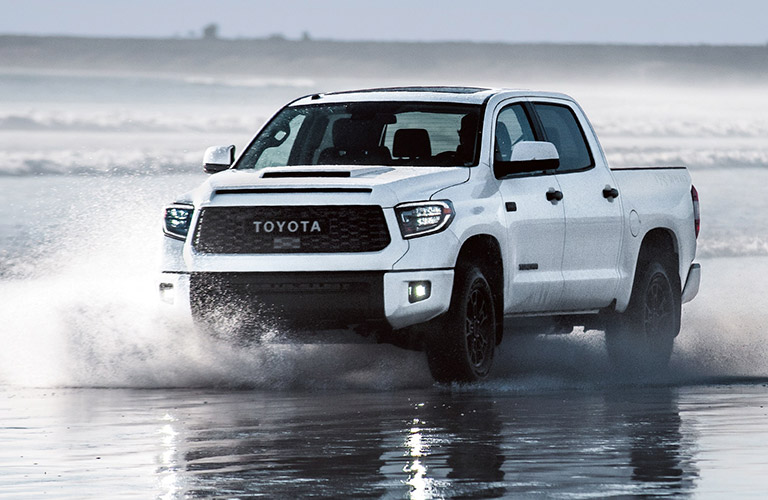 white 2019 Toyota Tundra in the water