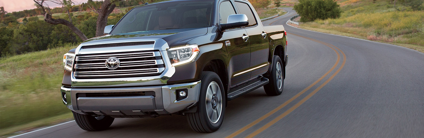black toyota tundra driving on road