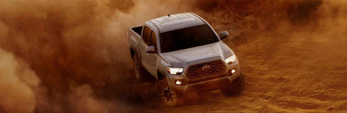 white 2020 toyota tacoma in dust cloud
