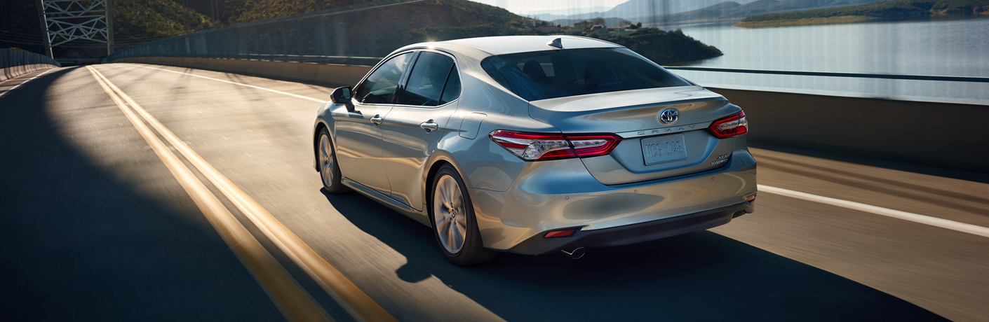 silver camry hybrid on the road
