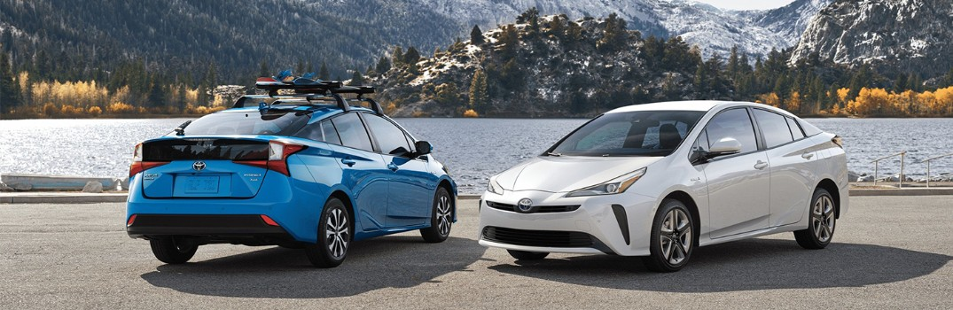 two 2020 Toyota Prius models parked next to each other