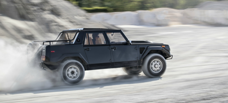 Lamborghini LM002 black side view in sand