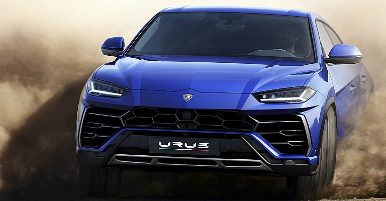 Lamborghini Urus blue front view sliding in sand