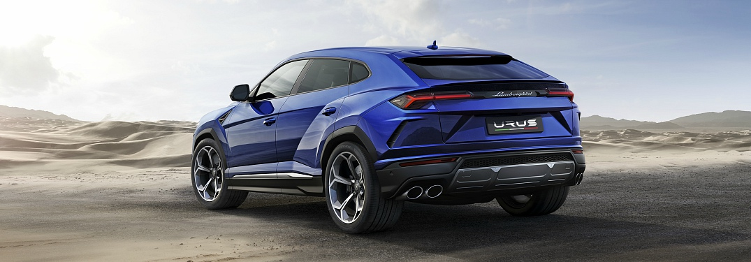 Lamborghini Urus blue back view in the desert