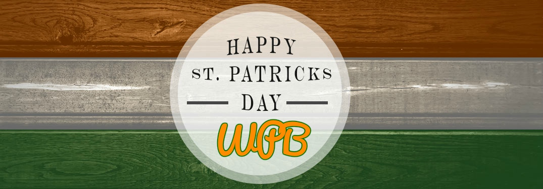 Happy Saint Patrick's Day WPB on wood background