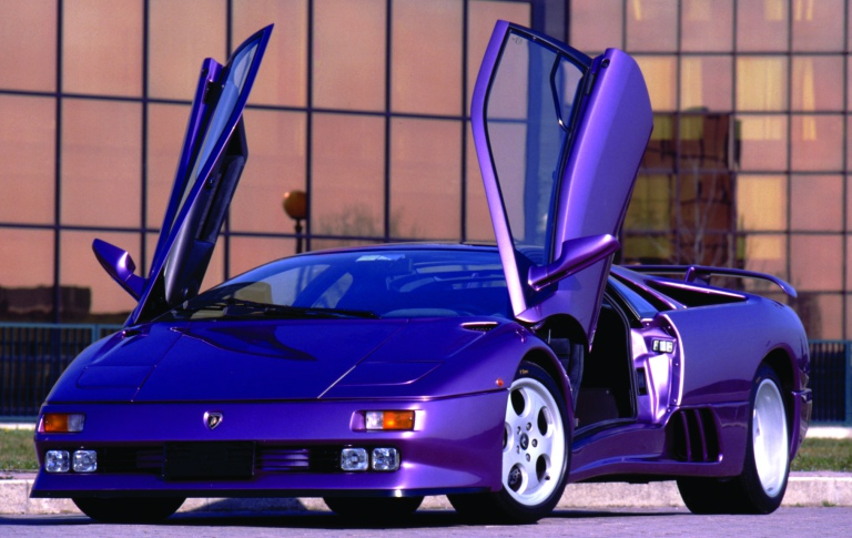 Lamborghini Diablo purple with scissor doors open side view