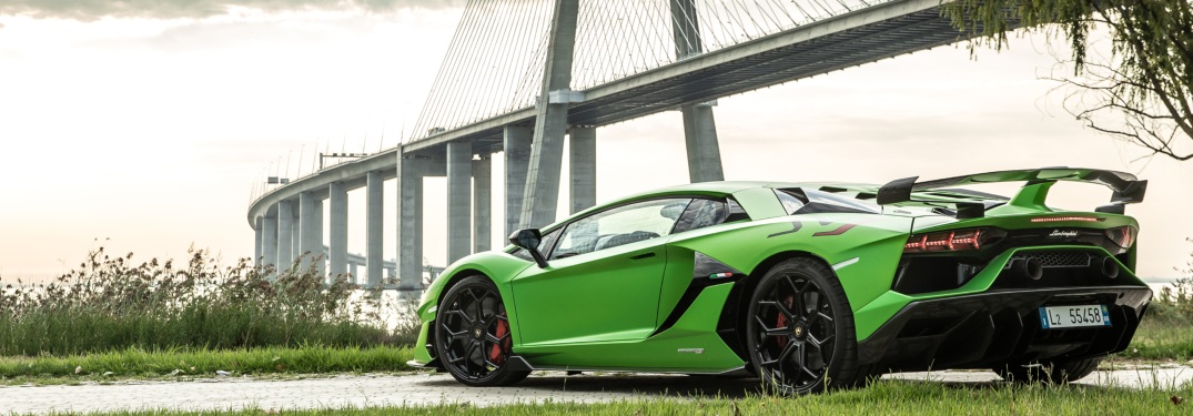 Lamborghini Aventador SVJ green back view in front of a bridge