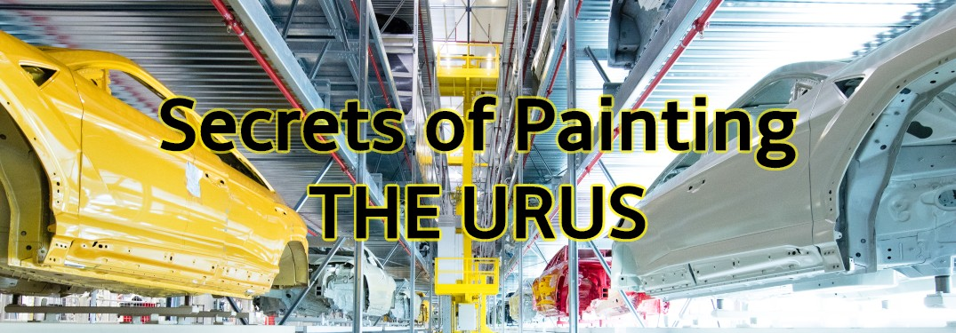 Two Lamborghini Urus bodies in the paint facility with text Secrets of Painting the Urus