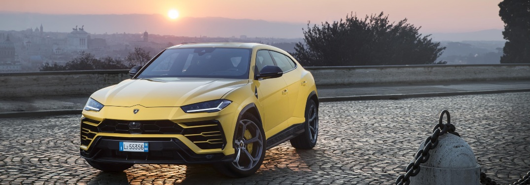 Lamborghini Urus yellow front view at sunrise