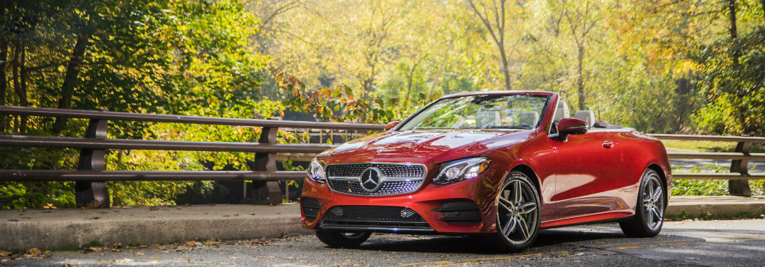 Red-2018-Mercedes-Benz-E-Class-Cabriolet-driving-in-front-of-park