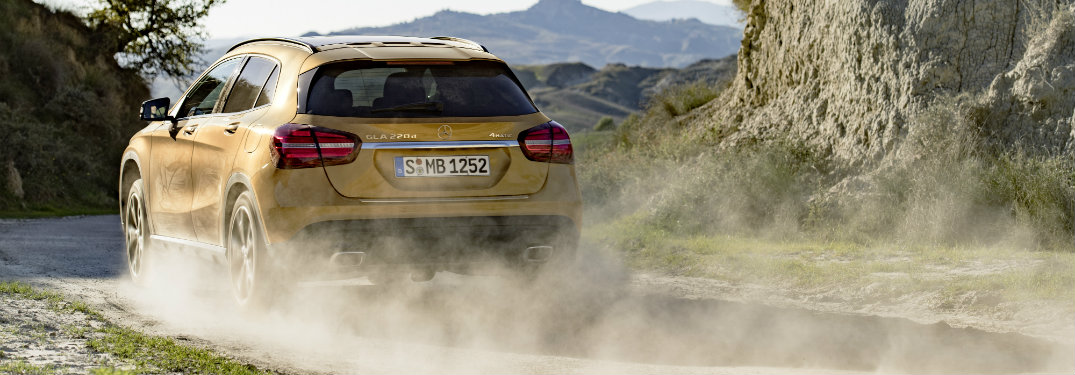 Rear-view-of-2018-Mercedes-Benz-GLA-driving-away-on-dusty-road