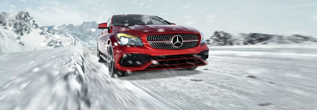 Front profile of the 2017 Mercedes-Benz CLA driving on snow in a mountainous area