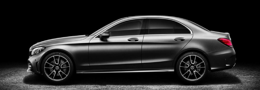 Side profile of the 2019 Mercedes-Benz C-Class in a dark room