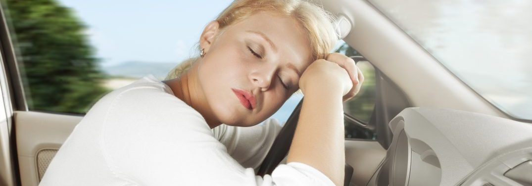 Young woman sleeping while driving