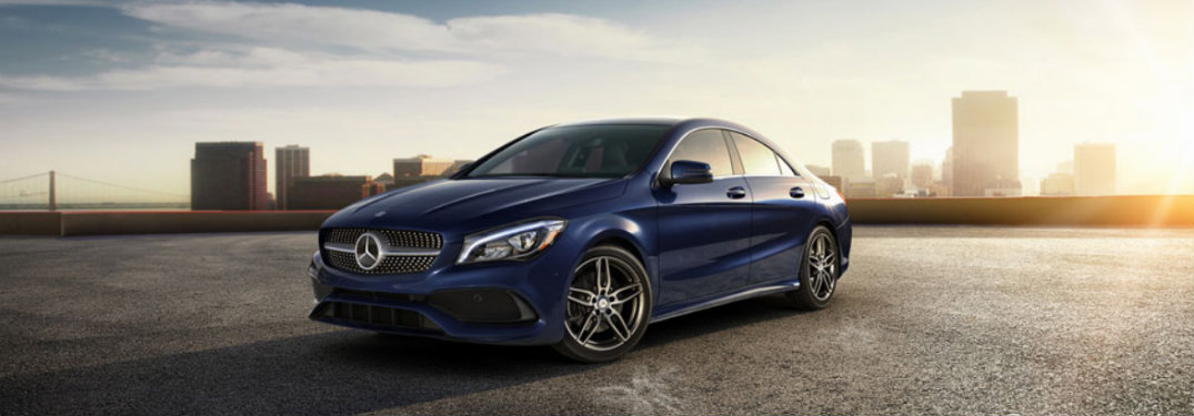 Blue-2018-Mercedes-Benz-CLA-in-front-of-city-skyline