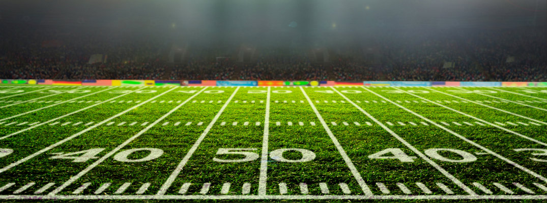 football stadium at night with a big crowd