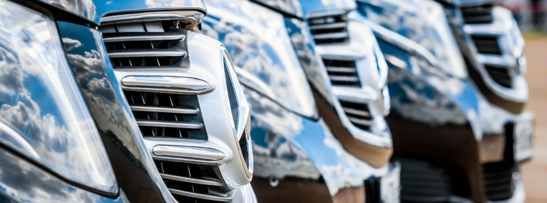 Mercedes-Benz grilles reflecting blue sky and clouds