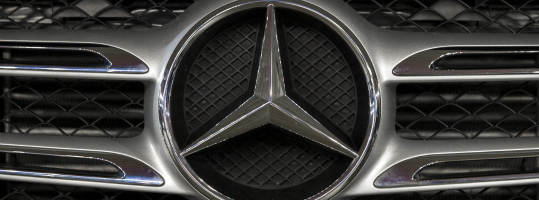 close up of mercedes-benz logo on grille
