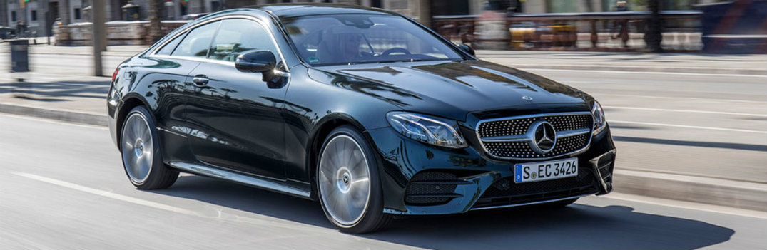 2018 Mercedes-Benz E-Class Coupe driving down a city highway